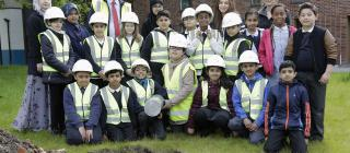 (Photo shoot 0616-017). Pupils from St James and Rosehill Federation School in Derby plant a time capsule at the Compendium Castleward development in the City Centre. Pictured with Compendium Project Manager Ian Woodland (red tie)
