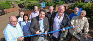 Stoke on Trent South MP Rob Flello cuts the ribbon to officially open the Weston Heights development, accompanied by, from left, Lovell Midlands regional director Steve Davis, Compendium Living project coordinator Wendy Lister, Riverside operations manager Cilla Aram, Stoke City councillor Ross Irving, Axis Design Architects director Mike Menzies, Compendium Living managing director Dave Bullock, Stoke City Council regeneration programme manager Phil Brundrett and Coalville Residents Association chairman Ernie Clarke.